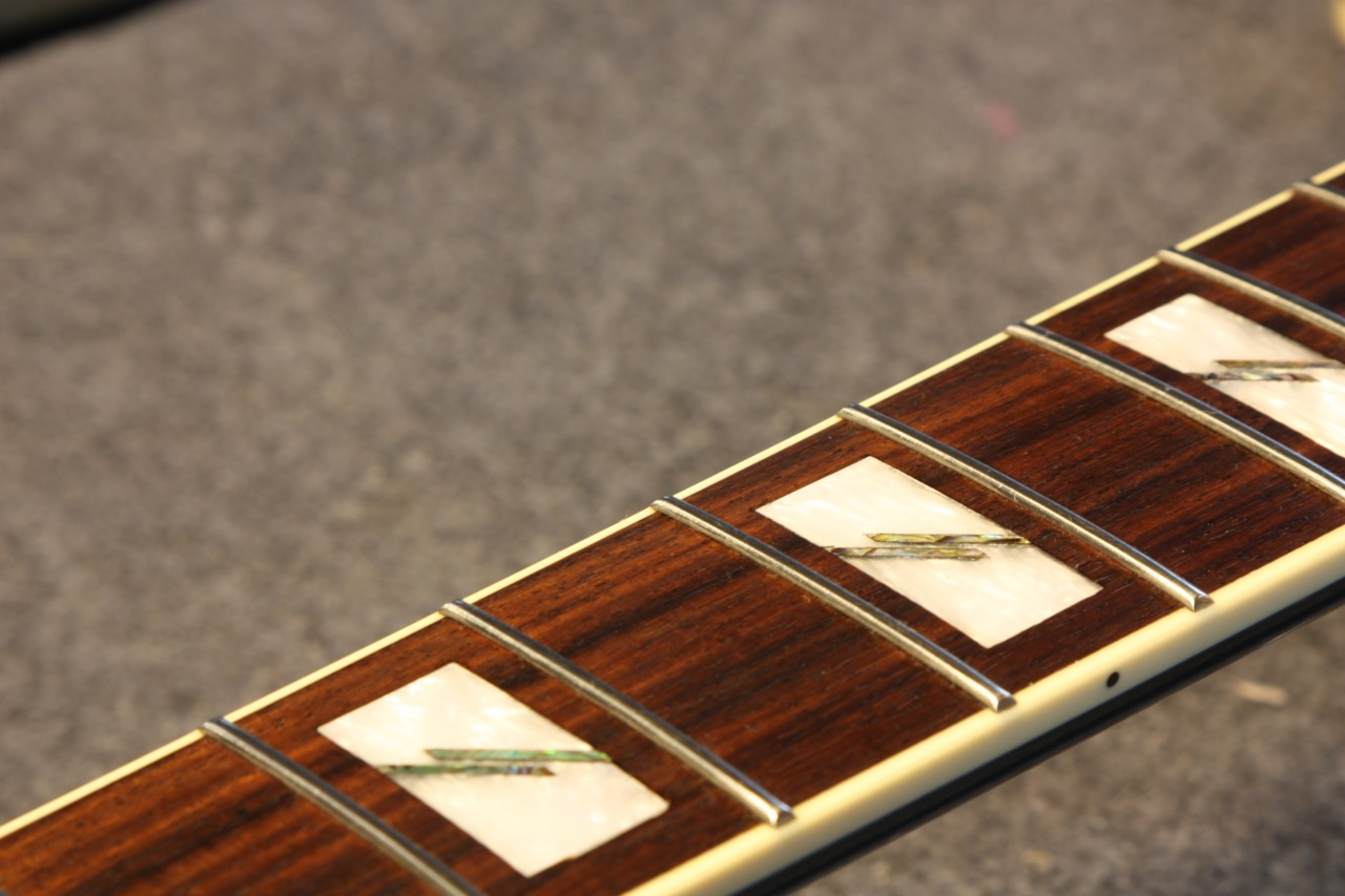 After level, crown and polish. Frets 3-5 alt. view. Fingerboard restored with Fretboard Serum
