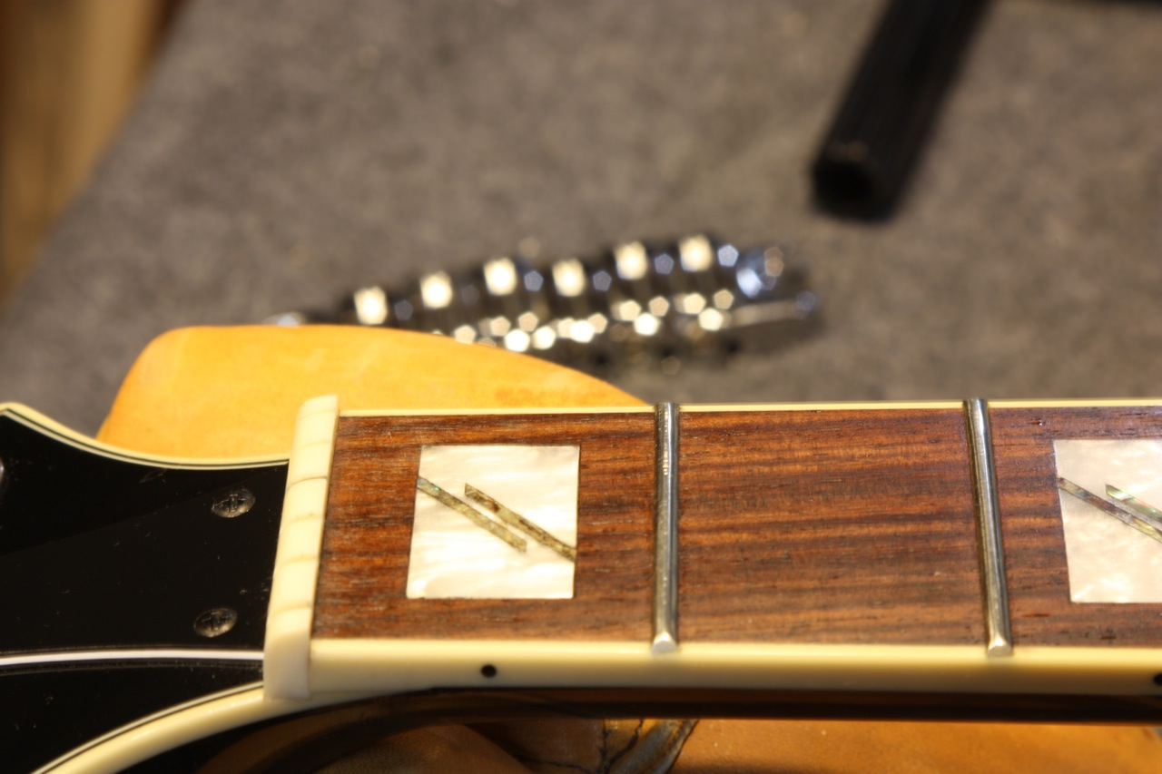 After level, crown and polish. At the nut. Fingerboard restored with Fretboard Serum