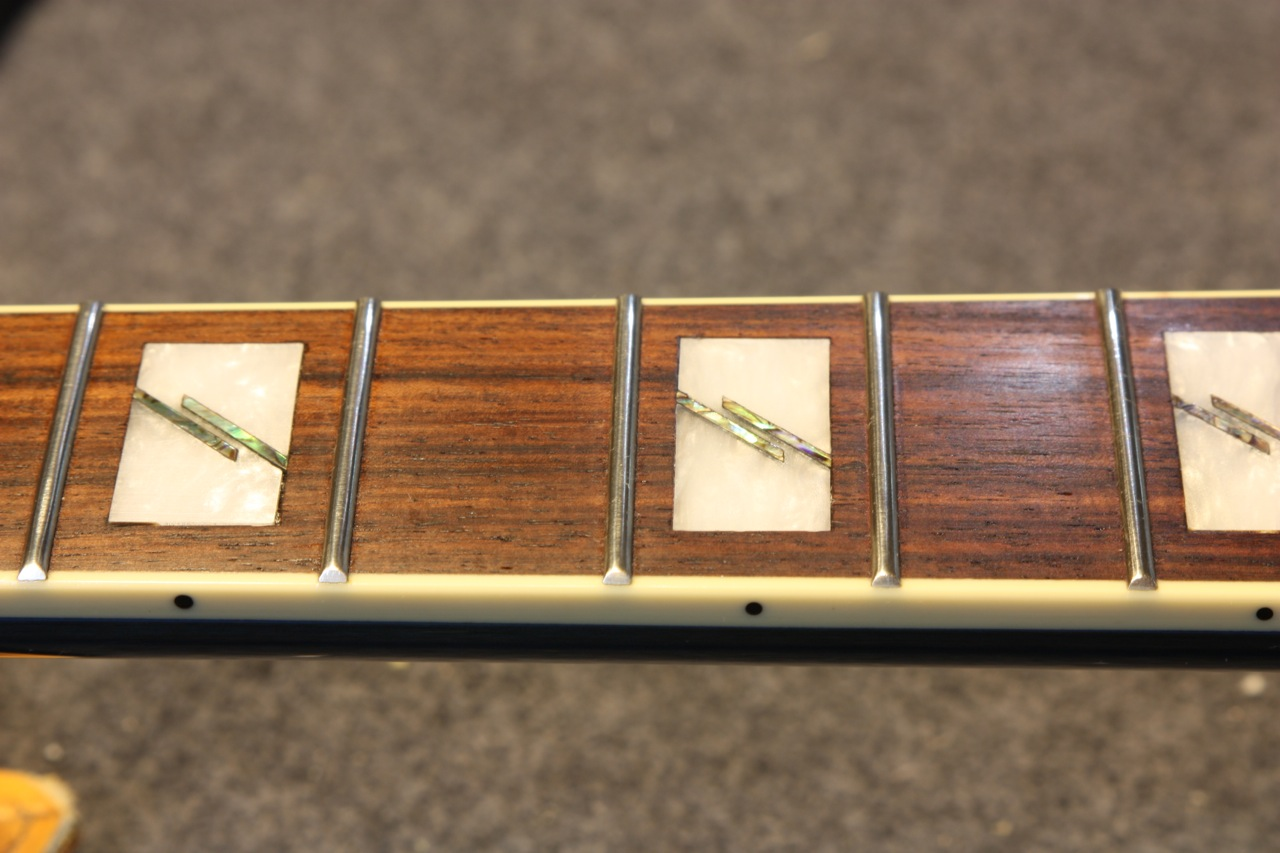 After level, crown and polish. Frets 3-5. Fingerboard restored with Fretboard Serum