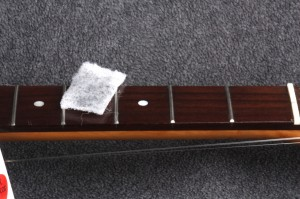 Gunk revealed! This is what I picked up off the board and the tarnish from the frets