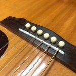 """AFTER bridge was """"shaved"""" and resurfaced. Treated with FretFactor Fingerboard serum (no stain or other finish). NICE 12"""" radius TUSQ Compensated Saddle"""