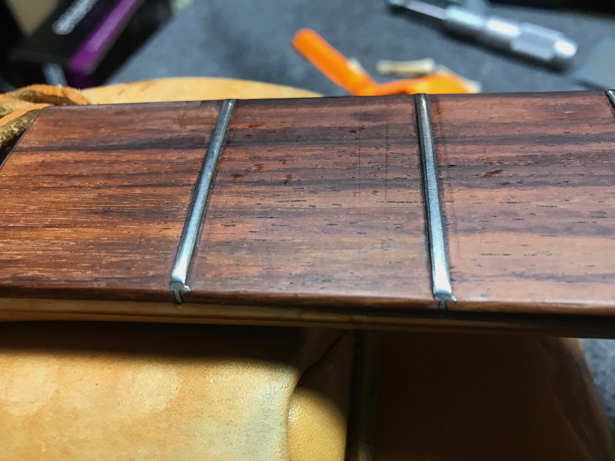 AFTER but note the burr on the fret on the left, left side bottom of image. Used polished side file to de-burr and then polished to match the rest of fret